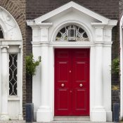 Doors in different colors painted as protest against English King George legal reign over the city of Dubline in Ireland