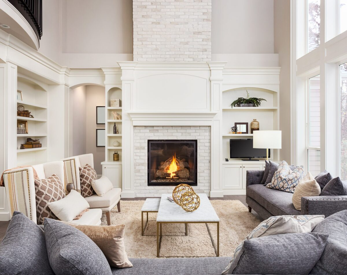 luxury living room with a fireplace